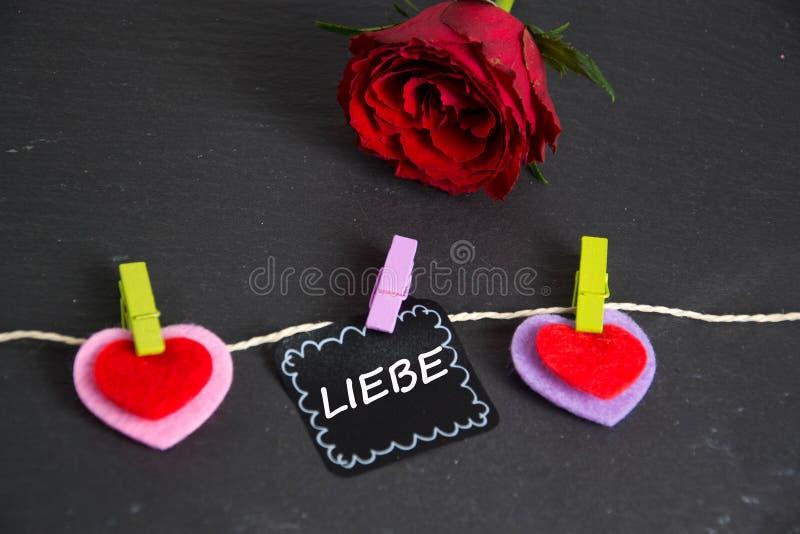 Liebe - det tyska ordet för förälskelse royaltyfria bilder