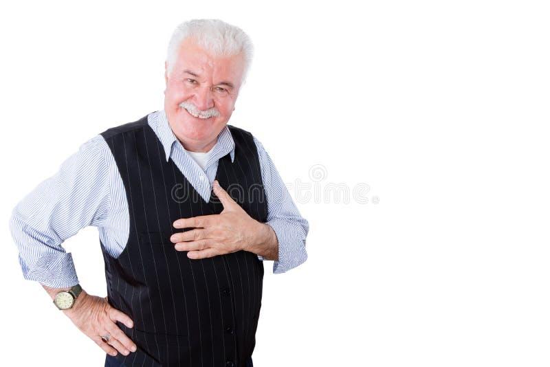 Liebenswürdiger höflicher älterer Mann, der seine Dankbarkeit zeigt lizenzfreies stockbild