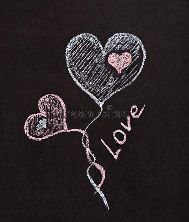 Liebhaber des Herzens - Zeichnung mit Kreide stockfotografie