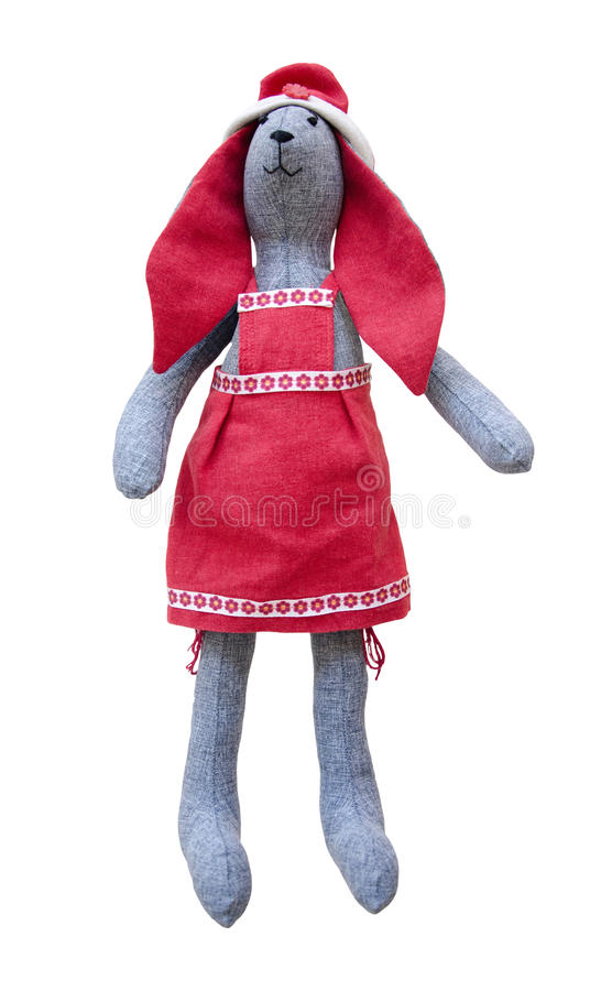 Liebres hechas a mano aisladas de la muñeca con los oídos rojos en delantal rojo imágenes de archivo libres de regalías