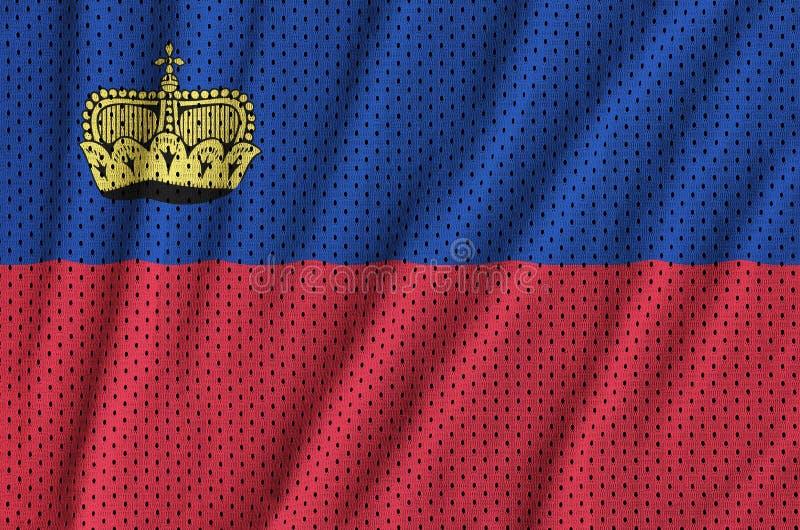 Liechtensteinsk flagga som skrivs ut på ett ingrepp för polyesternylonsportswear arkivfoto
