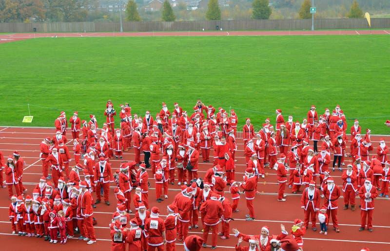 Liefdadigheid Santa Race stock fotografie