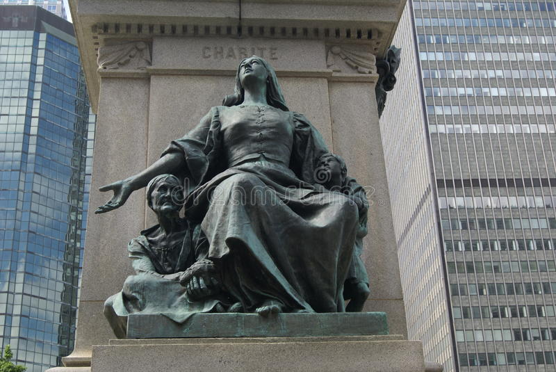 Liefdadigheidsstandbeeld, Detail van Ignace Bourget Monument in Montreal, Quebec, Canada stock foto