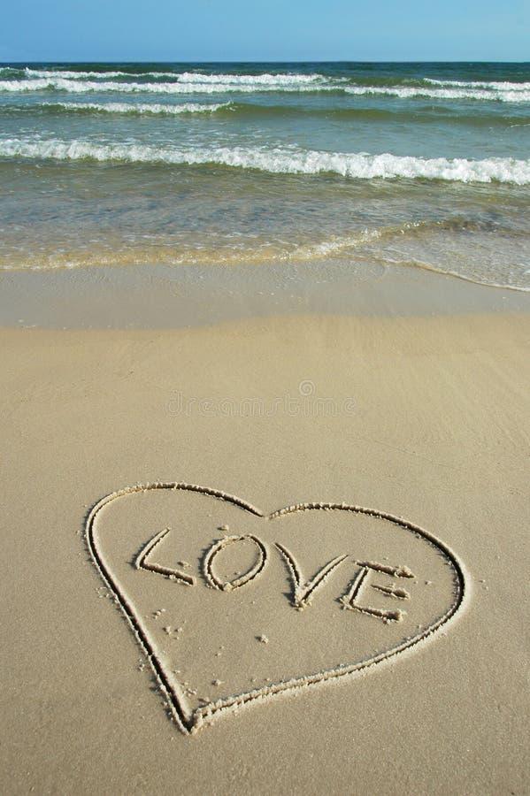 Liefde en Strand stock afbeelding