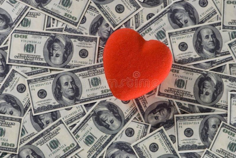 Liefde over geld stock fotografie