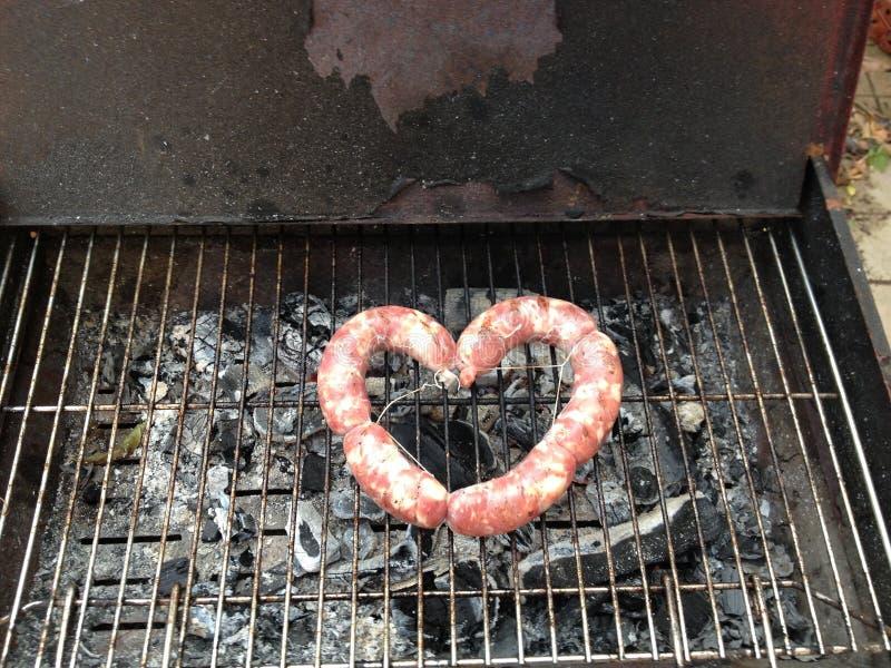 Liefdebarbecue stock afbeeldingen