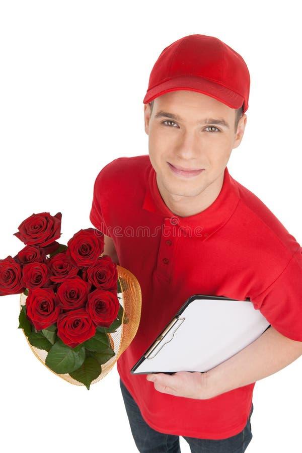 Lieferbote mit Blumen. Draufsicht des Lieferboteen ein bunc halten lizenzfreie stockfotos