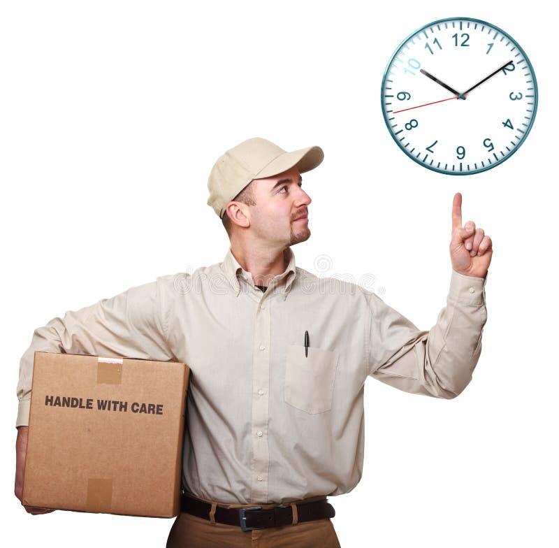 Lieferbote und Zeit lizenzfreie stockbilder
