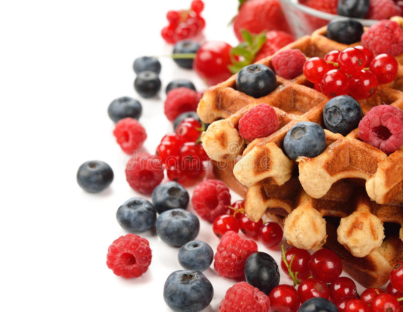 Liege waffles with berries. On white background stock photography