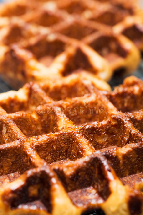 Liege waffles. Closeup of delicious fresh, Belgian Liege waffles with their characteristic caramelized pearl sugar exterior royalty free stock image