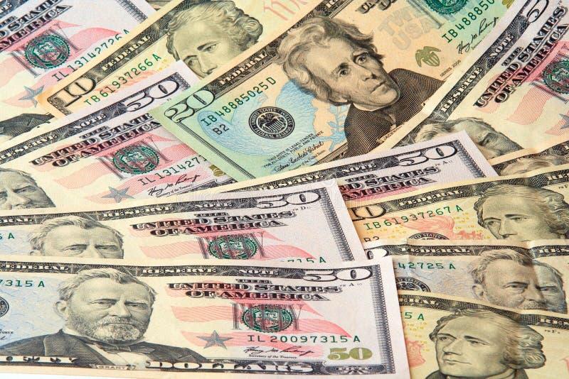 Liegenc$wachsen der Dollarbanknoten lizenzfreie stockbilder
