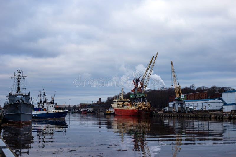 LIEPAJA, LATVIA - January, 2018: Liepaja seaport with port cranes. LIEPAJA, LATVIA - January, 2018 Liepaja seaport with port cranes royalty free stock photo