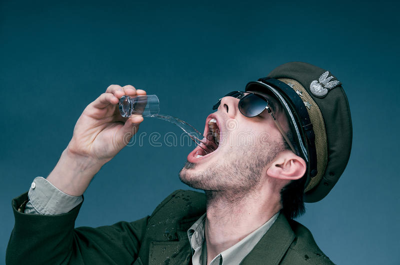 Lieutenant addicted to alcohol. Addicted lieutenant drinks to much because of stress royalty free stock photos