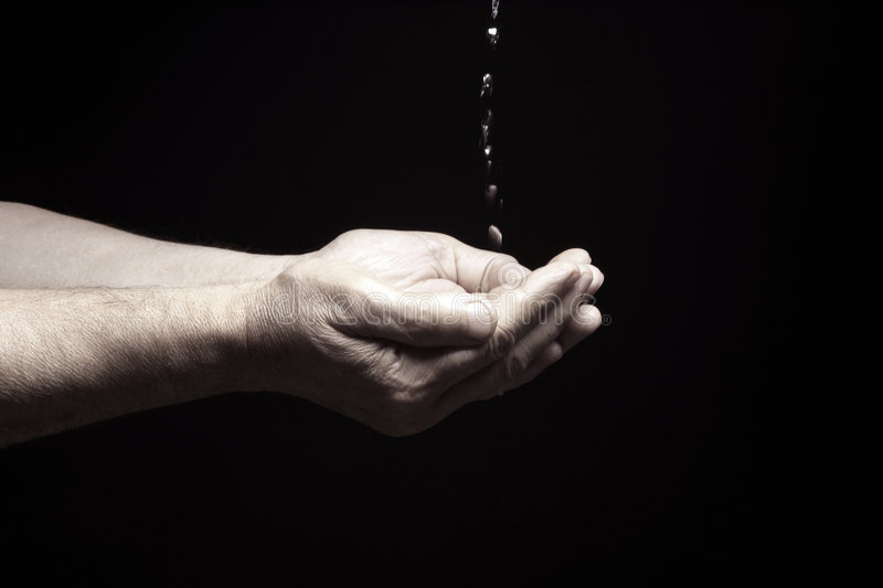 Life. Photo of an old male hands with water royalty free stock image