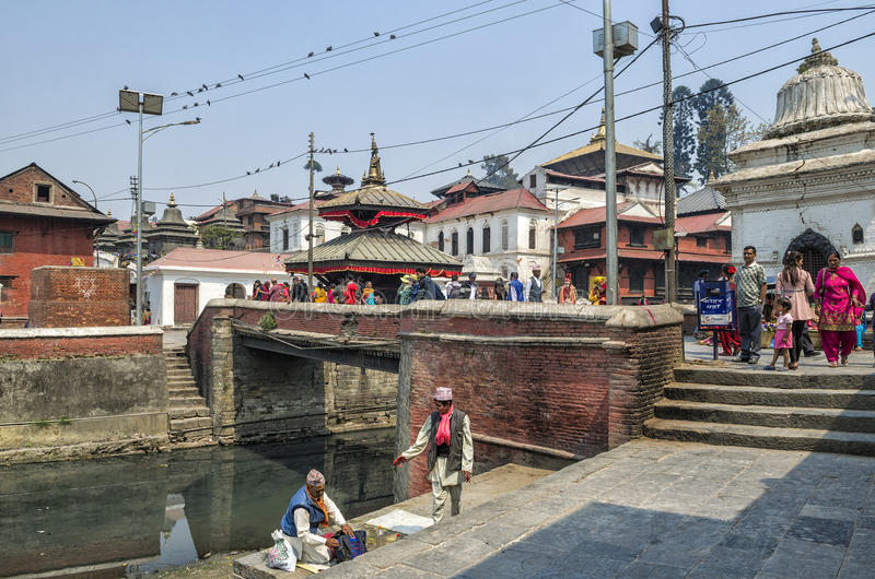 Life and activites along the holy Bagmati River at Pashupatinath Temple, Kathmandu, Nepal. royalty free stock image