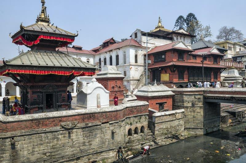 Life and activities along the holy Bagmati River at Pashupatinath Temple, Kathmandu, Nepal. Sri Pashupatinath Temple located on the banks of the Bagmati River royalty free stock photos