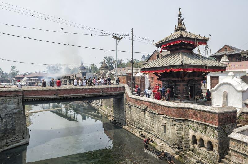 Life and activities along the holy Bagmati River at Pashupatinath Temple, Kathmandu, Nepal. Sri Pashupatinath Temple located on the banks of the Bagmati River stock images