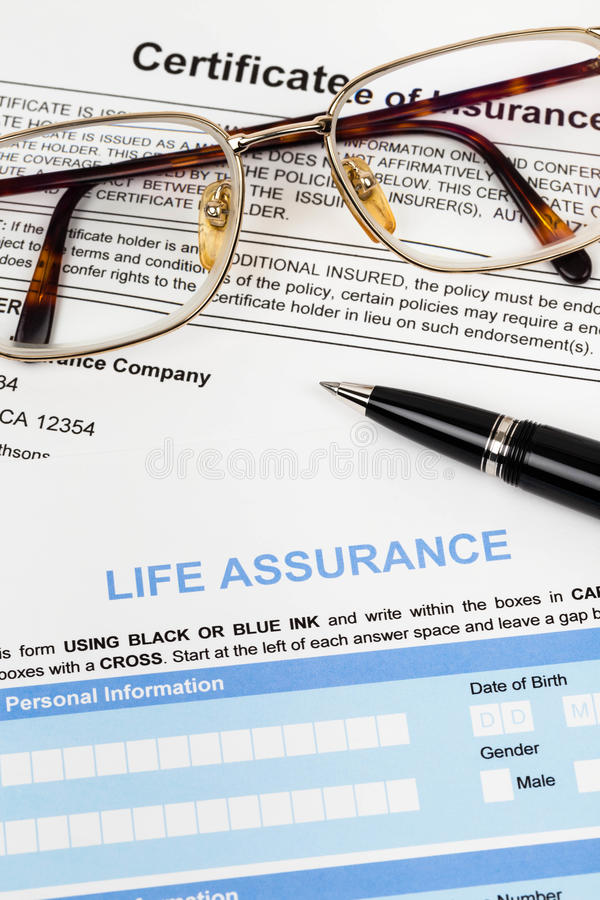 Life assurance application form with pen and glasses. Concept for life planning royalty free stock image