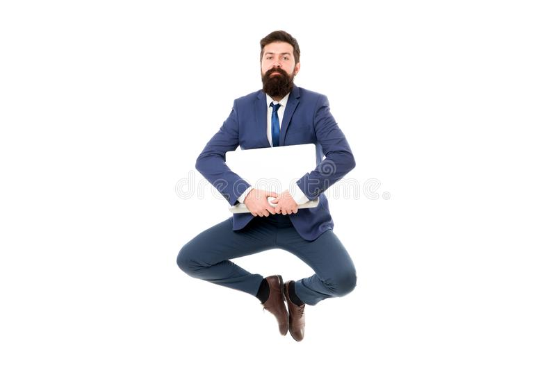 Life balance concept. Inspiring innovations. Businessman inspired guy feel peaceful. Man peaceful hold laptop jump royalty free stock images