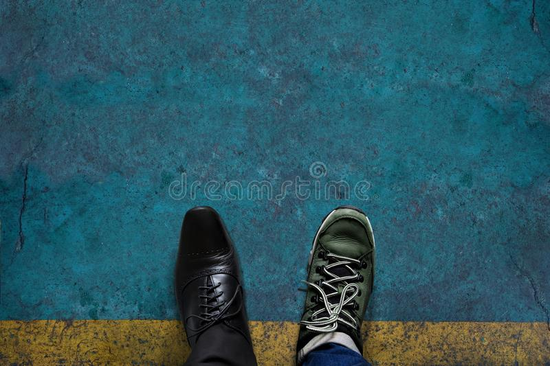 Life Balance Concept for Work and Travel present in top view position by half of Business Oxford and Adventure shoes, Grunge royalty free stock image