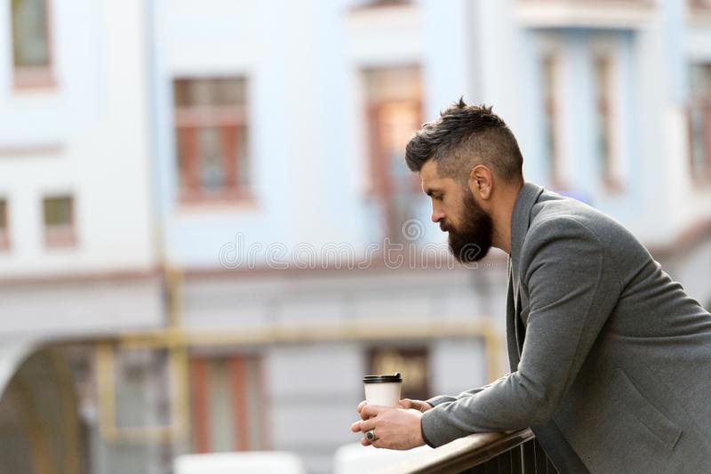 Life begins after coffee. Bearded man enjoying morning coffee. Businessman in hipster style holding takeaway coffee. The. Best time of day to drink coffee stock images