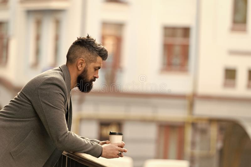 Life begins after coffee. Bearded man enjoying morning coffee. Businessman in hipster style holding takeaway coffee. The. Best time of day to drink coffee royalty free stock photo
