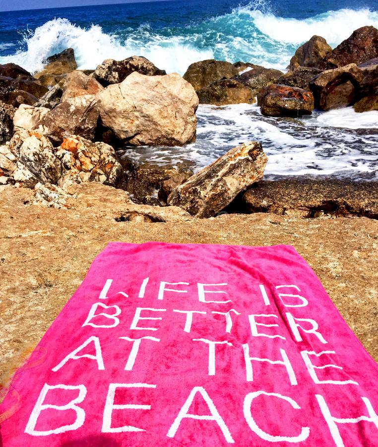 Life is better at the beach stock images