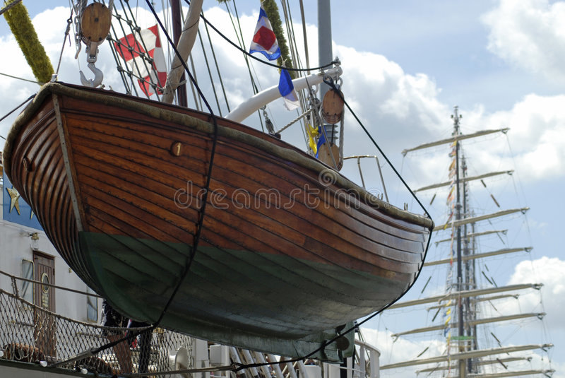 Life boat of a tall ship. Wooden life boat of a tall ship stock photos
