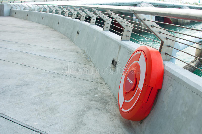 Life Buoy. A life buoy in the enclosed casing along the stainless steel railing stock photography