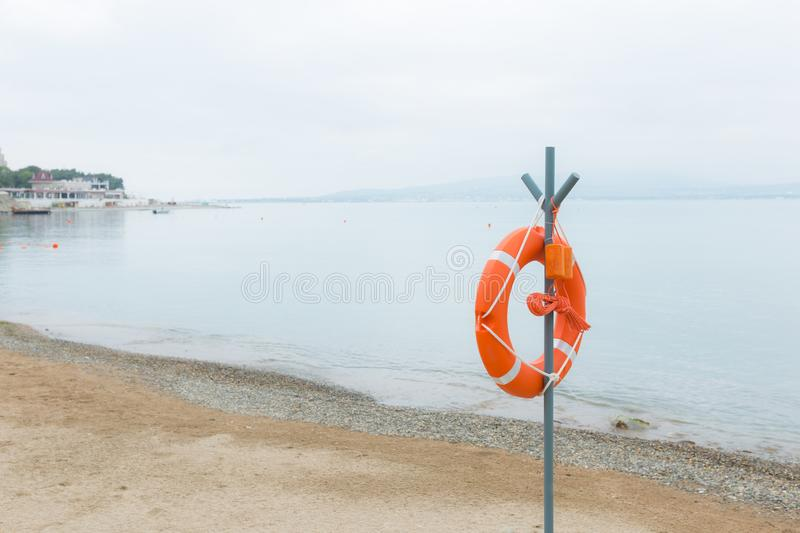 Life buoy attached to a post at the beach royalty free stock photography