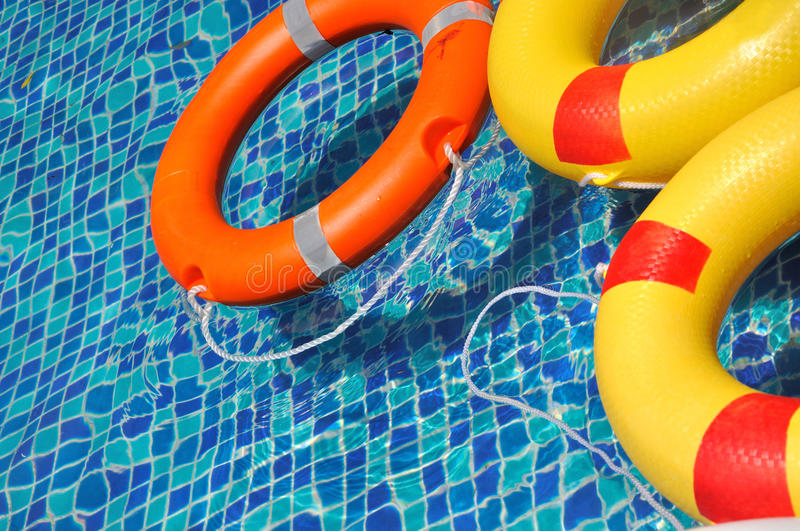 Download Life Buoy Floating In Swimming Pool Stock Image - Image: 20822555