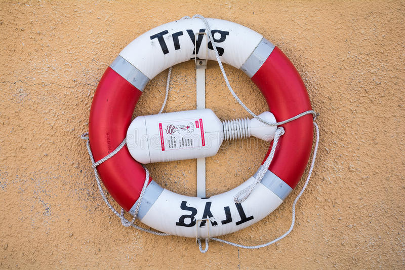 The life buoy is hanged around Tonsberg marina for safety and rescue stock image