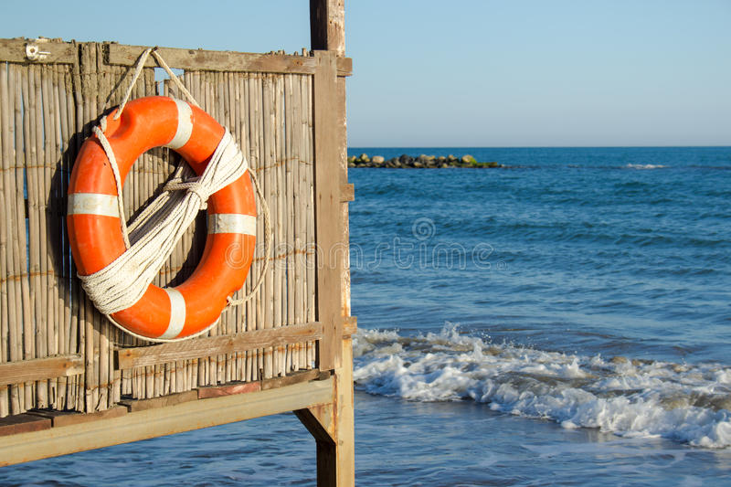 Life buoy on lifeguard tower. A life buoy on the beach, summer time stock image