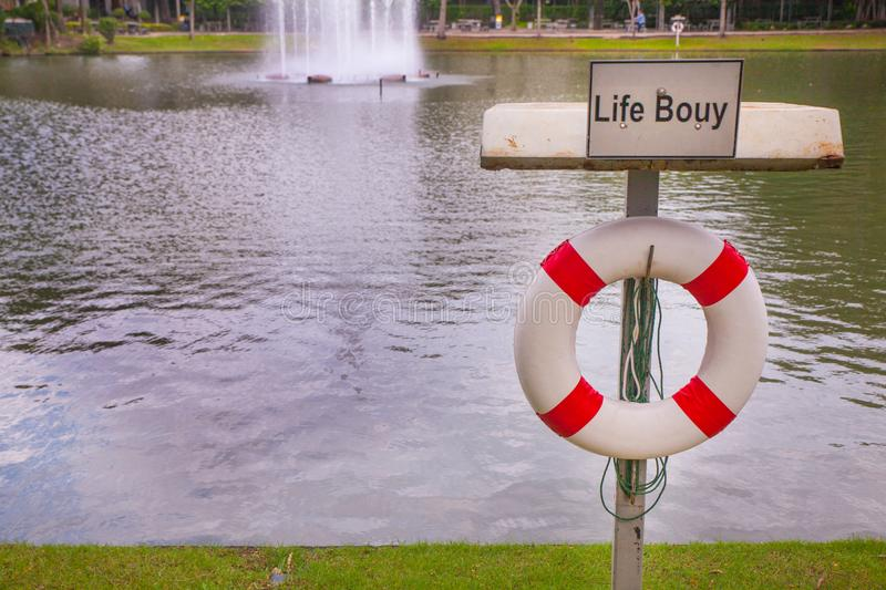 Life buoy near the pond royalty free stock photography