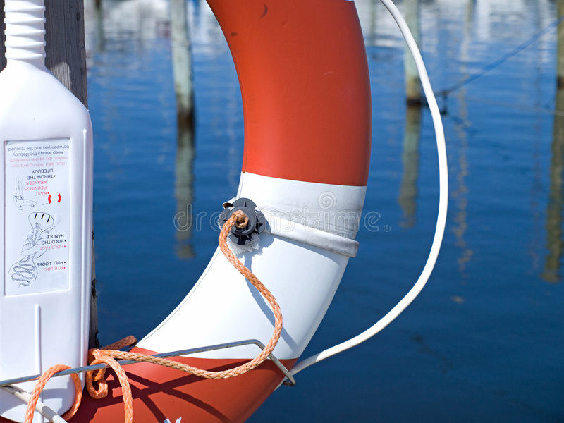 Life buoy preserver ring belt. In a marina stock photos