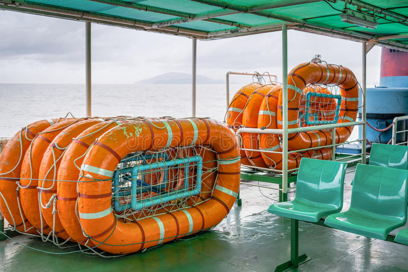 Life buoy stack on ship or boat for security and safety concept royalty free stock images
