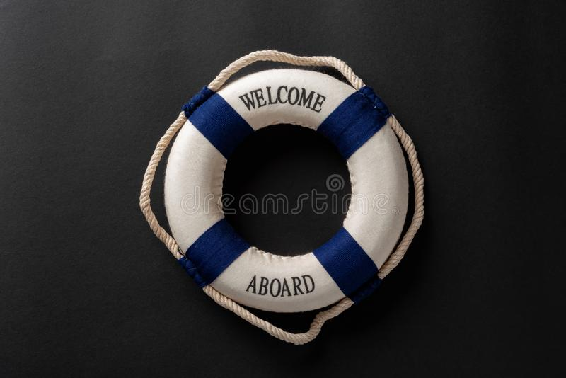 life buoy written with welcome aboard on dark background royalty free stock images