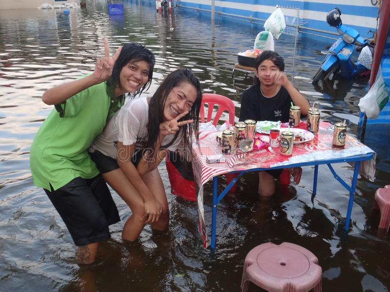 Life and business are as usual in flooded Pathum Thani, Thailand, in October 2011.  stock photos