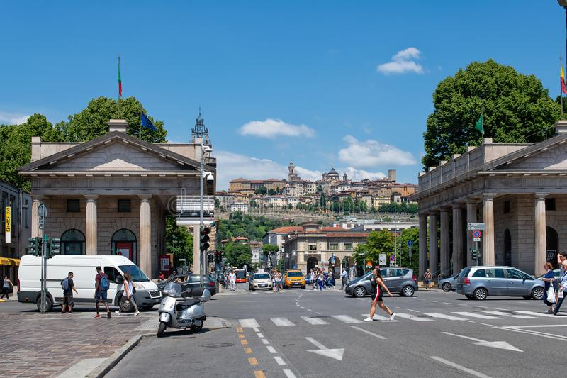 Life of the city center of Bergamo with the upper city in the ba royalty free stock photo