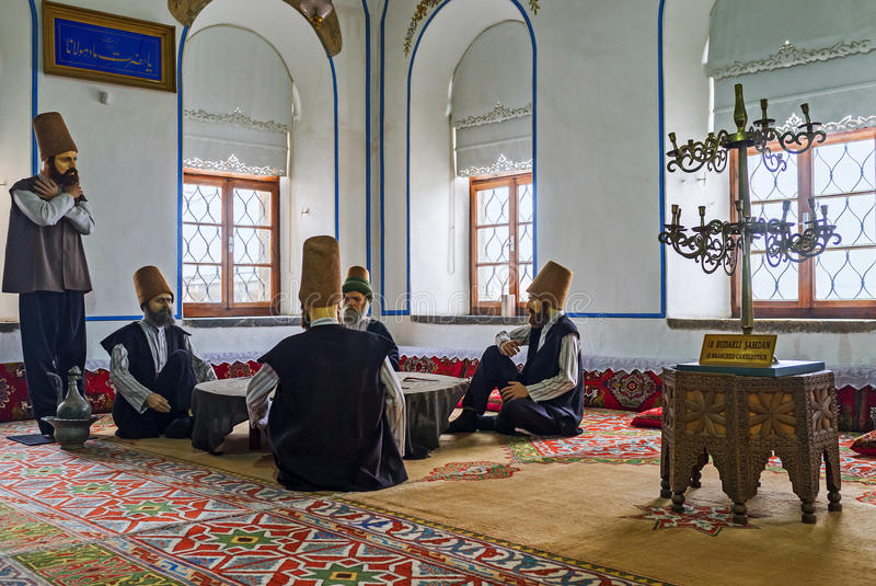 The life of dervishes. KONYA, TURKEY - JANUARY 20, 2015: The mannequins of dervishes in Mevlana Museum depict the scene from everyday life of the members of the stock image
