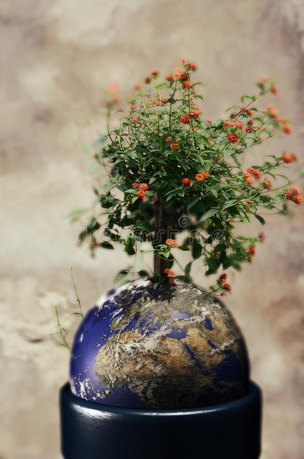 Life on Earth. Flowers growing up on the Earth, as if it was into a pot