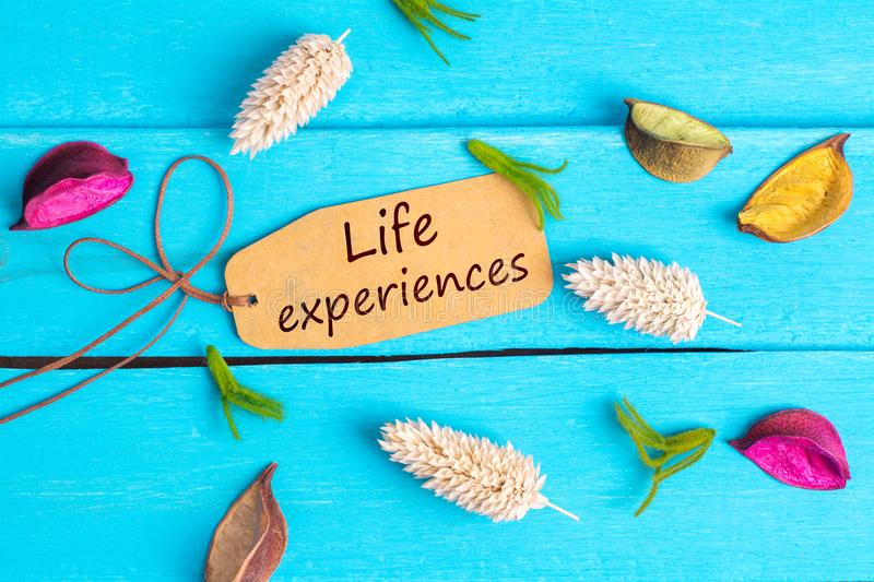 Life experiences text on paper tag stock photography