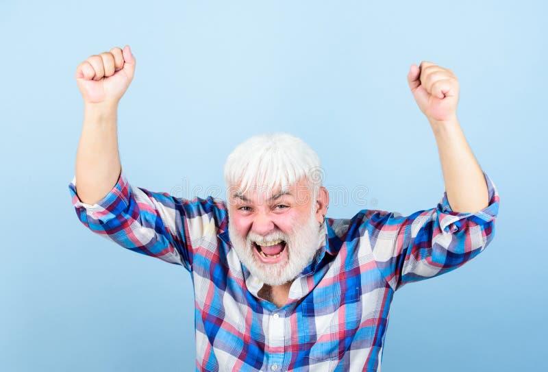 Life goals. Successful man celebrating achievement. Successful hipster lucky guy. Grandpa happy cheerful joyful stock photography