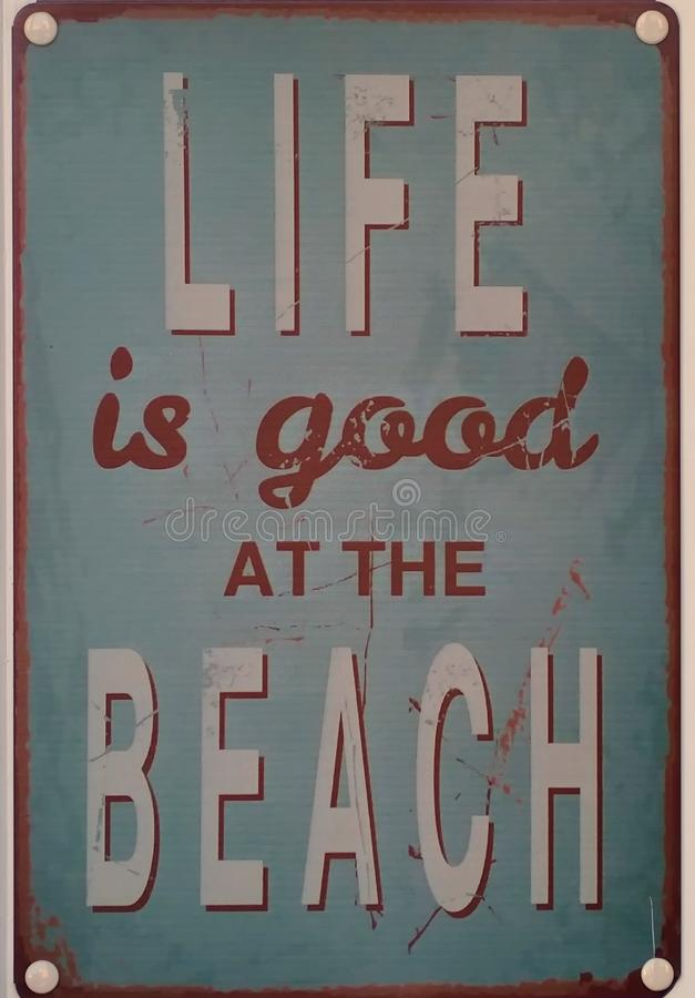 Life is good at the beach. weathered retro style sign. Vintage royalty free stock photo