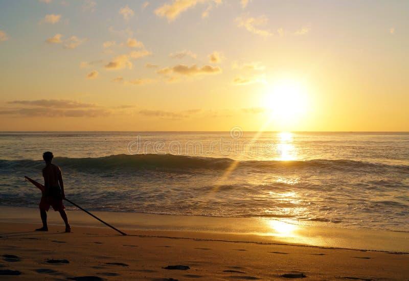 Life-guard and the setting sun stock image