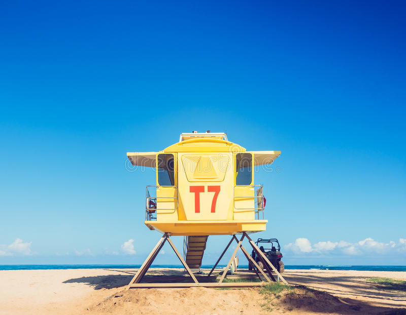 Life guard tower. Yellow life guard tower on tropical beach stock photography