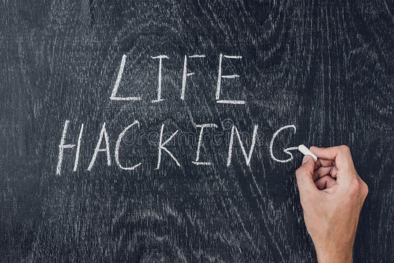 Life hacks written on the blackboard using chalk royalty free stock image