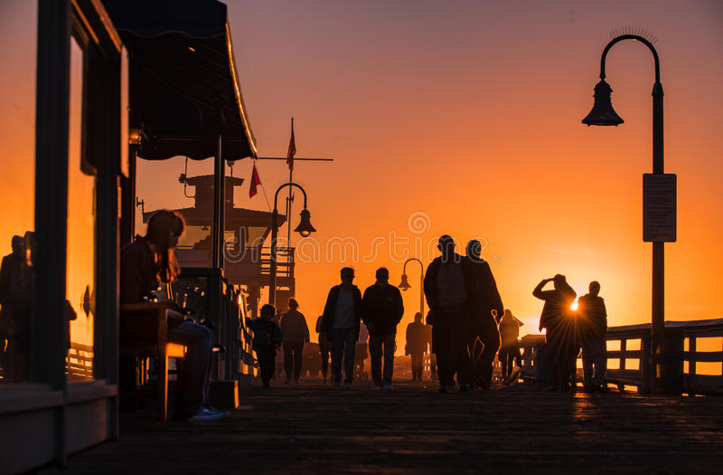 Life Happening in Southern California. Silhouettes of couples enjoying life on San-Clemente pier in Southern California royalty free stock photo