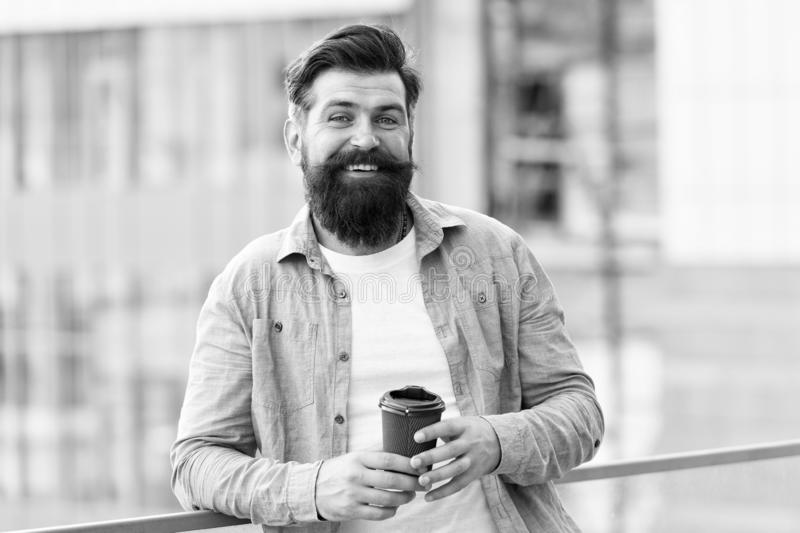 Life happens after coffee. Happy hipster drink takeaway coffee. Bearded man enjoy drinking coffee outdoor. Take away royalty free stock images