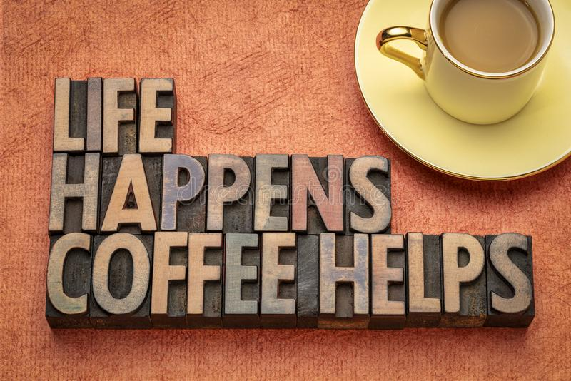 Life happens, coffee helps word abstract. Life happens, coffee helps - word abstract in vintage letterpress wood type with a cup of coffee royalty free stock photography